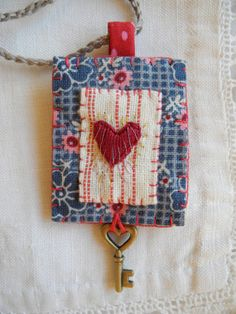 Embroidered heart stitching key charm necklace by giovabrusa