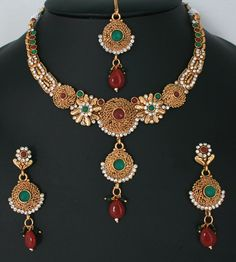 Costume polki Emerald and Ruby red stone Indian jewellery necklace set-011PLKJ62  http://www.craftandjewel.com/servlet/the-1727/Costume-polki-Emerald-and/Detail