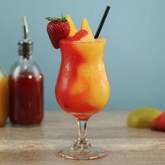 Mangos in Paradise MANGOS IN PARADISEOrange Layer: 1 oz ml) Mango oz ml) Mango Daiquiri Mix Strawberry oz ml) Strawberry oz ml) Strawberry Daiquiri Mix Rim: Colored Sugar Garnish: Mango Mango Rum Drinks, Mango Vodka, Mango Cocktail, Strawberry Daiquiri Mix, Mango Daiquiri, Strawberry Vodka, Vodka Recipes, Alcohol Drink Recipes, Cocktail Recipes
