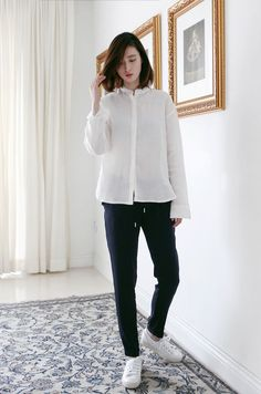 Another uniform-y look with a covered placket shirt and sneakers.