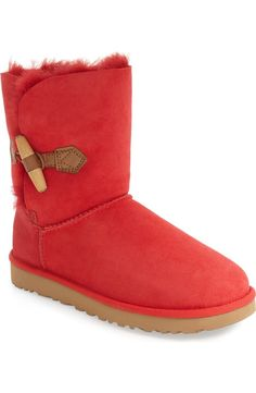 A toggle embellishment adds a touch of vintage style to this short UGG boot in a bright red.