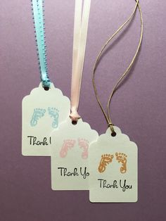 24 Adorable baby shower tags - so cute your guests will love them! These hand stamped favor tags for the baby can be in pink or blue and be used for Baby Shower favors, Goody Bags, Thank You favor gifts or Baby Shower prize gift tags. The gift tags have footprints stamped in the color you choose with Thank you stamped in black and each have ribbon or twine attached.  **See picture for different ribbon styles**  White 67 lb Card Stock 1.85 Width x 3.00 Length 24 tags with 12 inches of ribbon…
