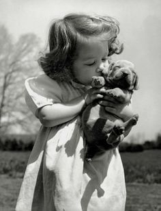 Girl kissing a puppy - Vintage Photography