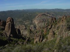 Pinnacles National Monument, CA - This north-facing view from the High Pinnacles is toward Balconies Cliffs in the distance (center right). High ridges of the northern Gabllan Range are in the distance. The once-horizontal rock layers have been tilted by geologic forces.