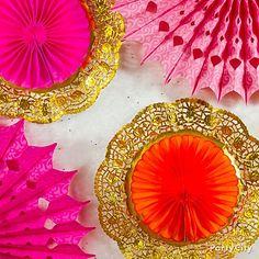 Paper fans + gold doilies = glam backdrop for a pink and orange candy buffet!
