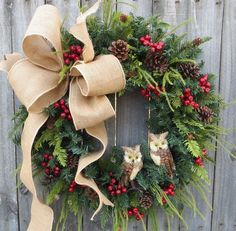 In this Christmas and wintertime wreath, a lovely burlap bow and a pair of adorable owls are the focal point. Beautiful greenery, berries, and pinecones make beautiful backdrop. This wreath is perfect for use during Christmas and through winter. This wreath was created using an artificial Canadian pine base measuring 23 tip to tip. Indoor/Sheltered Outdoor Safe *avoid too much direct sunlight as fading will occur over time We create a wire loop on the back of the wreath for easy hanging...