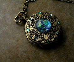 Pocket Watch - Dream Drop - Opal like green orange purple pink blue - Color Shift - Steampunk Timepiece Gothic - All Seeing Eye - Color Shifting GLOW Betwixt Regal - Orange And Purple, Purple Gold, Pink Blue, Magical Jewelry, Unique Jewelry, Uv Black Light, Pocket Watch Necklace, Ring Watch, Fantasy Jewelry