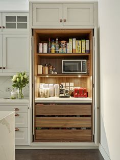 Breakfast / pantry cabinet with shelf lighting, power supply for small appliances and worktop. Little Greene's 'French Grey' is used on the kitchen cabinet doors with oak interior.