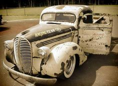 caixabox.   If someone can please tell me what this awesome pickup is made up of.  I've never seen a grill like this.  It's been 'chopped' and the windshield looks like the rear window from a 40's coupe.  ---Libby