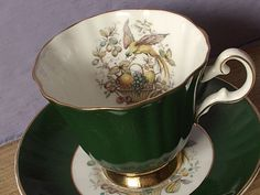 Vintage bird tea cup, 1950s Royal Grafton English bone china. Dark Green with white, decorated with birds and gold banding and trim