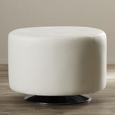 "Earleton Swivel Ottoman by Wade Logan / $192.99 at AllModern / 17.25""H 25.75""Dia / 29 lbs. / faux leather & Chrome"