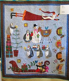 """""""Ho Ho Ho"""" by Ruth Lyons, Folsom Quilt and Fiber Guild.  Photo by Jenny K. Lyon at Quilt Skipper.  The design is 'Friends for Christmas' by Lynette Anderson."""