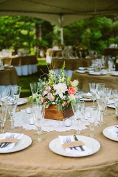 Doiley center pieces on round tables with burlap table covers