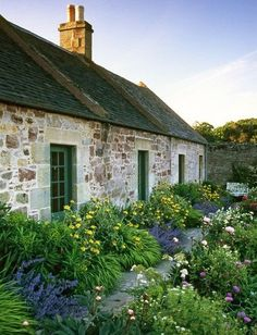 The stone house adds to the charm of this beautiful garden.