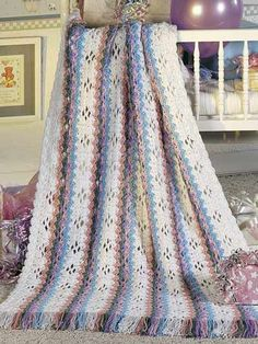 Free Rainbow Stripes Baby Afghan Crochet Pattern -- Download this free crochet baby blanket pattern from FreePatterns.com!
