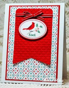 handmade Christmas card from Stamping with Klass ... red for the cardinal challenge ... like the background patterned paper with red mat ... wide fishtail banner with embossed texture, a riboon and an oval holding the main image ... sweet card!!