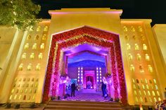 Are you looking for wedding decor in some traditional shades? Here is a beautiful yellow wedding decor with a touch of magenta pink elements! Purple Wedding Decorations, Stage Decorations, Yellow Purple Wedding, Wedding Gate, Purple Wisteria, Wedding Stage Design, Floral Chandelier, Black Vase, Pink Garden