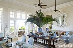 """""""The living room in our house in Punta Cana, Dominican Republic, is filled with pieces we have had for years in other houses. The large-scale furniture makes the room feel comfortable for a group, or for one person who has just picked up a book."""" —Bunny Williams   - HouseBeautiful.com"""