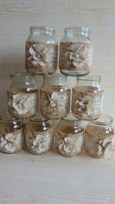 This listing is for a set of 10 hand-decorated jars. Decorated with burlap, lace and handmade flower fabric. They make a wonderful accent to your wedding whether its rustic, woodland, barn shabby, or vintage! This listing is for 10 jars . Rustic wedding decor, Lace and burlap mason jar, burlap