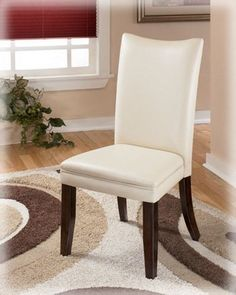 "Metro Modern White Charrell Dining Upholstered Side Chair (Set of Two) by Famous Brand Furniture. $199.46. Includes 2 chairs. Chair upholstery features a natural faux leather. 20"" W x 25.25"" D x 39.94"" H. Made with select veneer and hardwood solids. Medium brown finish. The straight-line contemporary design of the ""Charrell"" dining room collection features a warm finish and a clean look to enhance your dining room decor. The medium brown finish and the faux leather upholstered c..."