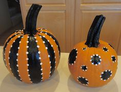 Painted Pumpkins - paint on black stripes or circles; use pencil eraser dipped in white paint to accent...