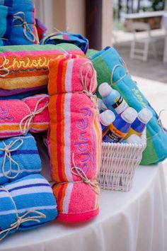 Beach Towel Wedding Favors great for a beach wedding. These may be expensive but even a smaller towel with a bottle of water with a custom label on it would suffice for that special beach ceremony!