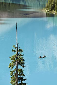 Canoeing on turquoise water of Moraine Lake, Valley of the Ten Peaks, Banff National Park, Alberta, Canada  CLICK THE PIC and Learn how you can EARN MONEY while still having fun on Pinterest