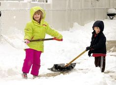 Sydney and Jake Myers, 6 and 2, respectively, of North Wildwood help their family shovel snow in the driveway.