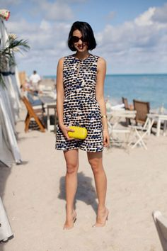 Lily Kwong lends her look a pop of yellow with a fun DVF minaudiere.