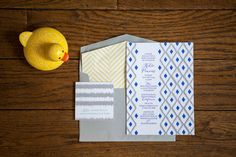#baby-shower, #invitations, #blue, #yellow  Photography: Maya Myers Photography - mayamyers.com  Read More: http://www.stylemepretty.com/living/2014/01/06/smp-living-graphic-print-inspired-baby-shower/