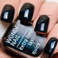 IsaDora - Spellbound Black - http://www.mynailpolishonline.com/2015/11/isadora/isadora-spellbound-black/
