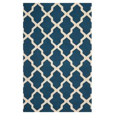 Featuring an exotic trellis motif, this hand-tufted wool rug brings an eye-catching pop of style to your decor.   Product: Rug