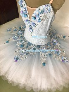 This blue professional tutus is decorated with beads and white laces. Perfect for paquita, raymonda, and many other classic ballet roles. There might be minor variation in final product due to lace batch changes. Please provide the following measurements: 1. Height (cm) 2..Weight
