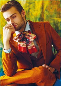 Douglas Booth dons a rich orange suit from Helen Anthony with a Theory shirt.