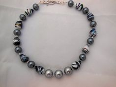 Necklace of gray, white and black glass beads