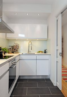 Simple but beautiful kitchen. Love the sliding door!