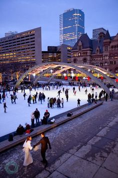 Nathan Phillips Square, Toronto.  LOVE this ice rink!!