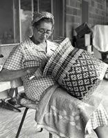 Eva Wolfe finishing a rivercane  basket
