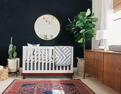 Mid-Century Modern Nursery - love the bold navy accent wall and fab lighting in this baby room for @alexandraevgen!