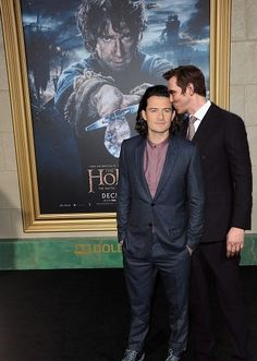 Orlando Bloom and Lee Pace. At the movie premiere doing something I'll leave to the imagination. ;) Like father like son?