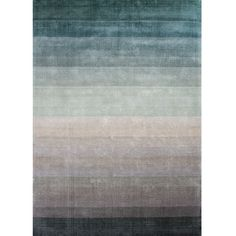 Linie Design Combination Rug in the Jade colourway is handloomed in India by skilled craftsmen. This contemporary design rug has been made very much for the modern interior and features a beautiful and subtle colour graduation, which goes through many variations of jade green through soft taupe to a dark grey, altogether making a stunning rug.