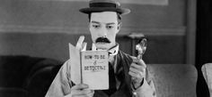 A kindly movie projectionist (Buster Keaton) longs to be a detective in the 1924 silent comedy film 'Sherlock Jr' Sherlock Holmes through the ages, in pictures Picture: Rex Features Silent Film Stars, Movie Stars, Classic Hollywood, Old Hollywood, Buster Keaton, People Reading, Silent Comedy, Comedy Film, Fritz Lang