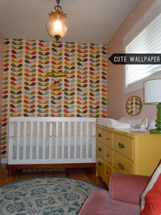 Yellow dresser and I adore the Orla Keily Wallpaper
