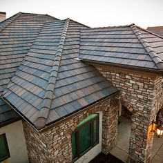 Boral Roofing Concrete Tile Hartford Slate Charcoal Brown Blend   Saxony 900 Hartford Slate receives a surface texture designed to emulate the surface of natural slate. This slate texture, combined with the colors carefully selected by our color consultant, will give the Hartford roof a unique and very distinctive appearance.