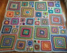 This afghan design was inspired by a magazine from the 1970s. I used 45 different colours to create this one-of-a-kind afghan. Crocheted by me using 100% acrylic yarn, afghan measures approx. 50 in. x 60 in. (127 cm x 153 cm). The afghan has 63 granny squares of 3 different sizes and not one square is the same. Squares and blanket are bordered in black. This afghan is made-to-order. Please see my shop banner for current completion time. ****************** © 2016 Crochet Kaleidoscope. This…