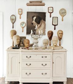 Indian hand mirrors, dog portraits, and Belgian wig molds from the 1890s converge in a charmingly offbeat installation in this New York home.