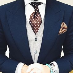 Navy blazer, light gray vest and dark chocolate polka dot tie, with milk chocolate pocket square and white shirt