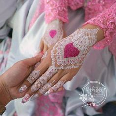 heart pattern white henna design or brides