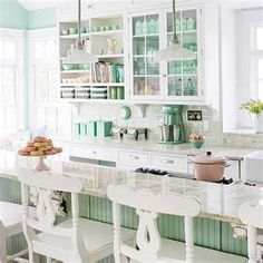 white kitchen with blue and green accessories