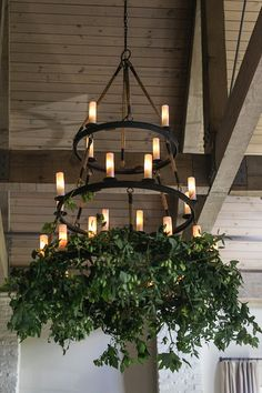 Garden or forest inspired greenery for a reception space chandelier - perfect for a summer wedding! #weddingflowers #receptionflowers #virginiaweddingflorist
